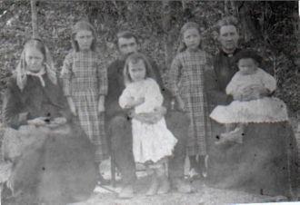 Adeline Whitaker with John W. Hooker family