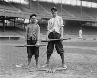 Unidentified boys in stadium with baseball bats