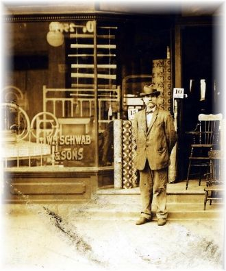 G Grandfather in front of furniture store