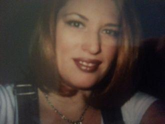 Suzanne E. Love