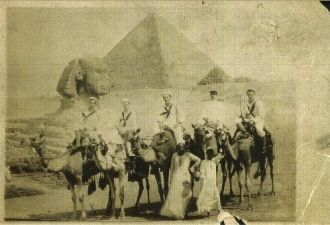 Navy Guys in Egypt in front of Pryamids on Camels