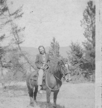 Uunknown female on horseback
