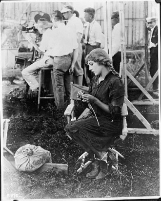 Mary Pickford knitting for Red Cross