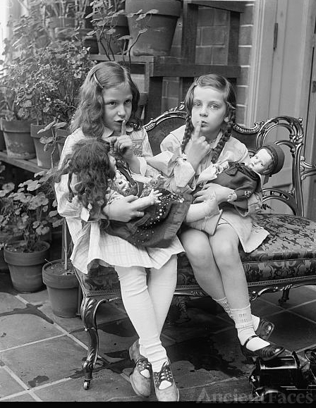 Two young girls with dolls