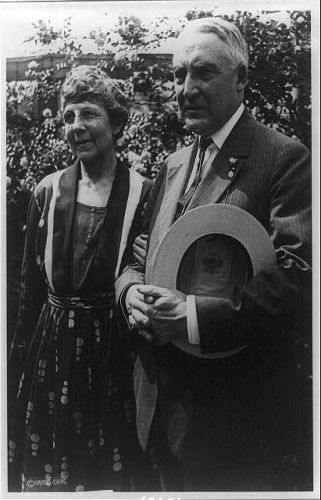 [Mr. and Mrs. Warren G. Harding standing, three-quarter...
