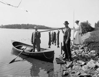 Two unknown men, fishing
