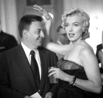 Earl Wilson and  Marilyn Monroe.