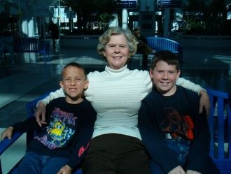 Grandmother, Frankie Davis Inman sits and waits with her grandsons for their dad's arrival from Iraq