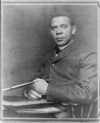 [Booker Taliaferro Washington, seated, facing left, with...