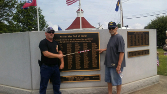 Claude Turner w/ cousin Larry Dickens. Pointing to his daddy's name on the veterans wall in the Village in Old Hickory,TN