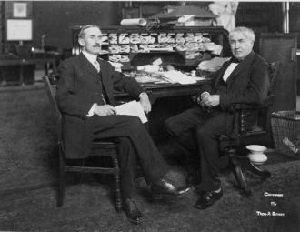 [Thomas Alva Edison, full-length portrait, seated at his...