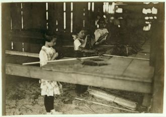Interior of tobacco shed, Hawthorn Farm. Girls in...