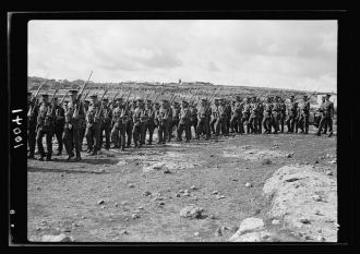 Arab demonstration at Yatta. British soldiers marching...