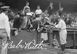 Babe Ruth autographing for fans