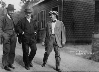 Mr. Thomas Edison walking in laboratory yard with Messrs....