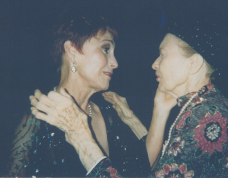 Julie May Wilson being caressed by Amanda McBroom.