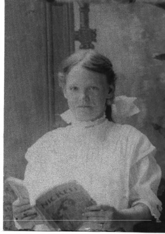 Ancestress? holding April 1899 Nickell magazine