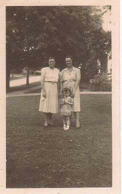 Marie (Coon) Greenwood, Annette (Coon) Pluckhan, Sisters, and Jamie, Annette's Son