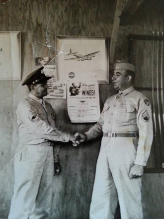 USAAF Staff Sergeant (at this time) Anthony Costanza shaking a Technical Sergeant (at that time), I am unsure of his name or anything else about the photo.