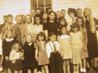 Mariam Joan Osborne with sisters (church?)