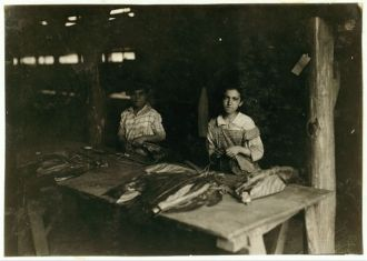 Young girls of 11, 12, 13 yrs., string in shed of...