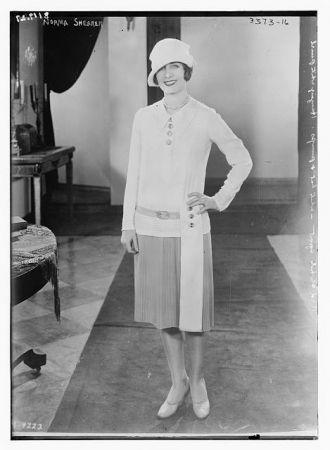 Norma Shearer [in short dress]