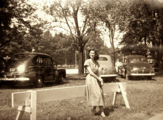 Possibly 1950's Girl and Parked Cars