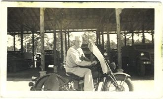 James Wesley  Holcomb on a motorbike