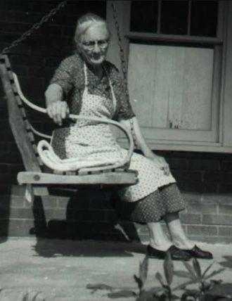 Della Jane SMEDLEY Foster Sitting on Her Porch