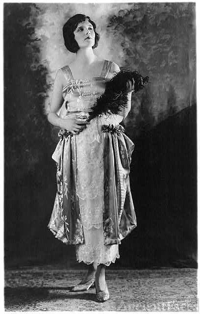 Woman modelling 1919 dress
