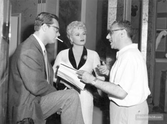 Judy Holliday, William Holden, and George Cukor
