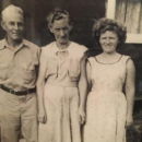 Parents of James Johnnie Mathis with one of his sister's. Mr Charles Emery Mathis and his wife Lora Ethel Mathis (parents) Johnnie's sister Hazel.