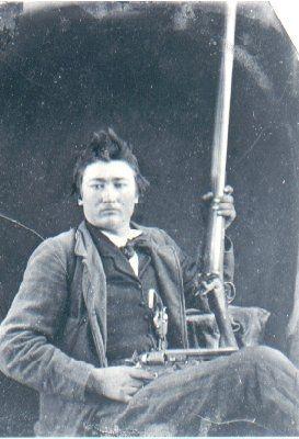 Possible Cherokee Man w/long gun & revolver