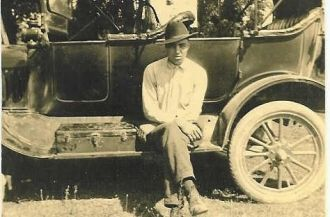 Ed Tyree Sitting On A Car's Running Board
