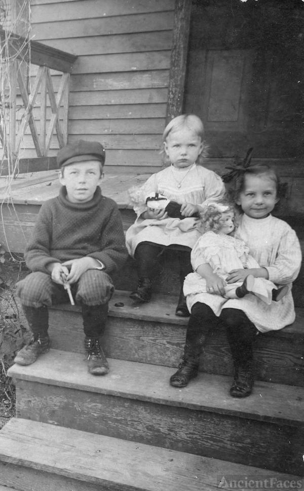 Three Children on the Steps