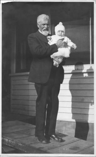 1918 My Great Grandpa Hubert Hiram Woodcock b. 1846, d. 1933 holding my Mother, Marjorie Bull