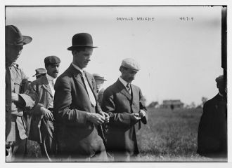 Orville Wright and crowd on flying field