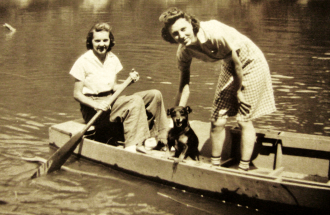 Two Women Boating with their Dog