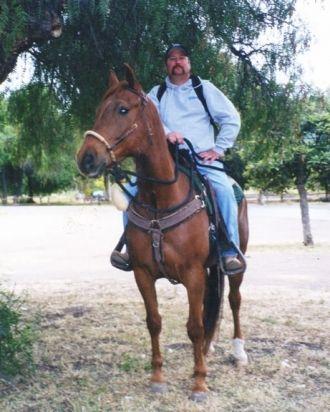 Charlie Ralph Merrill on horseback