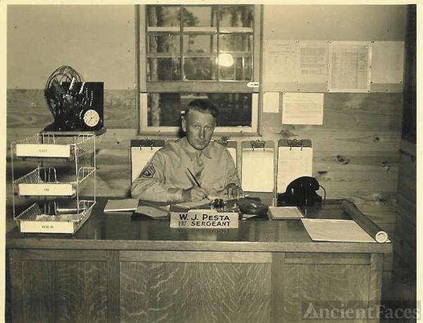 William J. Pesta Sr., First Sergeant, At His Desk