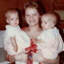 Brenda holding her twin daughters in NC