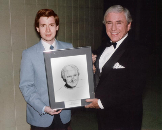 Steve Randisi presenting Merv Griffin with a portrait of himself.