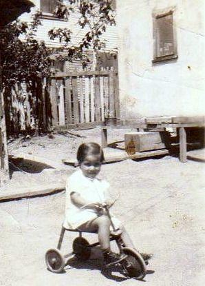 Virginia Espinoza on a tricycle