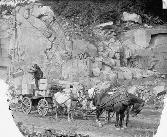 Concord, N.H., loading granite,