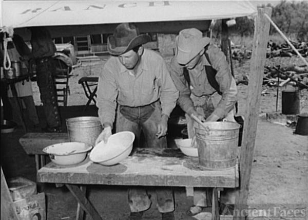Cowboys washing up before eating