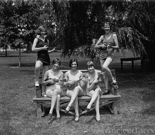 Women in bathing suits with ukuleles