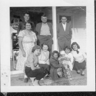 Family in front of Store