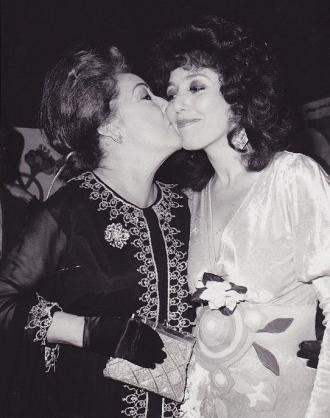 Ethel Merman kissing her daughter-in-law, Barbara Colby.