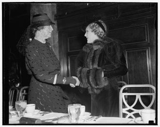 Wife of Secretary of State greets Mary Pickford as both...