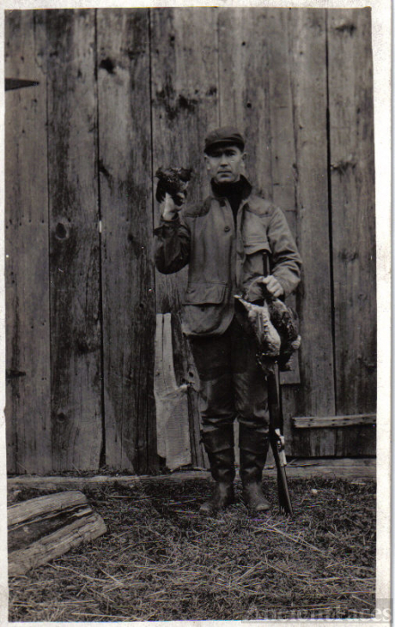 George Haire holding a live bird after hunting them